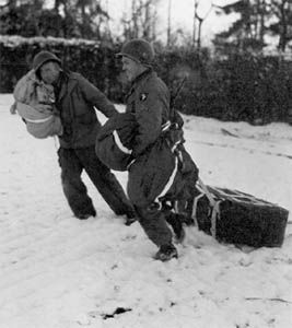 101st Airborne troops retrieving air dropped supplies during the siege of Bastogne.