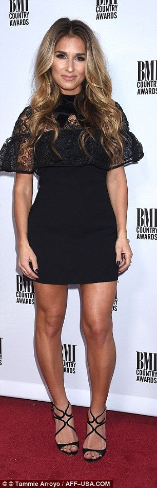 Head-to-toe black: Jessie James Decker's dress had a lacy cowl that fell almost to the elb...