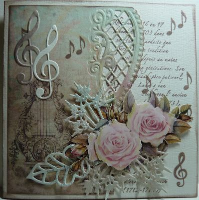 Anja Design. I like how this is so beautiful without using chunky flowers. Will fit nicely in an envelope.