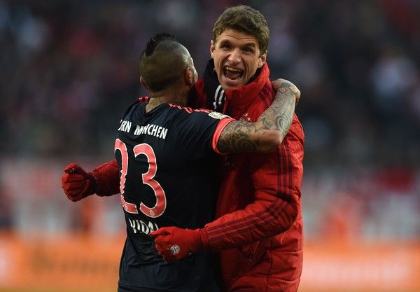 Bayern Munich's Chilean midfielder Arturo Vidal (L) and Bayern Munich's midfielder Thomas Mueller react after the German Bundesliga first division football match between FC Cologne vs FC Bayern Munich in Cologne, western Germany, on March 19, 2016.