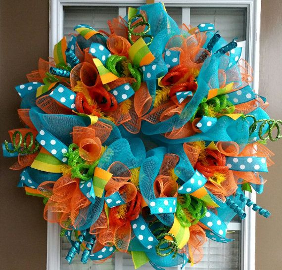 This wreath is made with deco mesh, mesh ribbons, tons of coordinating ribbons, glamour roping, and flex tubing. This is a large wreath which measures approximately 26x 26x 6. Please note: Exact ribbons may not always be available and may be substituted for ribbons in similar patterns and colors.