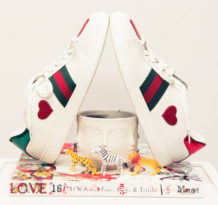 Designer Sneakers That Are Worth the Price: White Gucci sneakers with green and red stripes and red hearts | coveteur.com