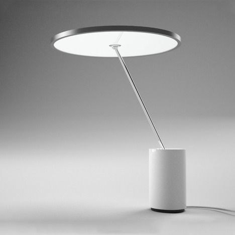 Sisifo by Scott Wilson for Artemide. A LED task and table light combined. A circle, an angle, a cylinder.
