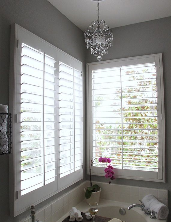 Gray bathroom walls white plantation shutters white for Indoor wood shutters white