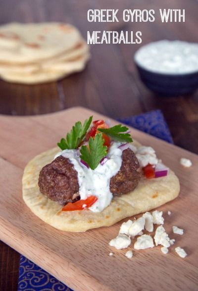 Greek gyros are simple to put together! Greek style meatballs on a pita topped with classic tzatziki sauce make a quick and delicious weeknight meal. Click through for recipe!
