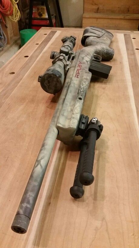 Remington 700 SPS with a custom distressed pain job.