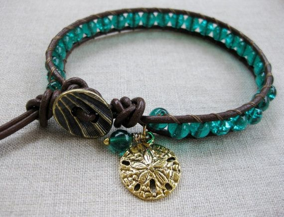 Emerald Sand Dollar - leather wrap coastal bracelet with gold sand dollar charm. - by SeaSide Strands
