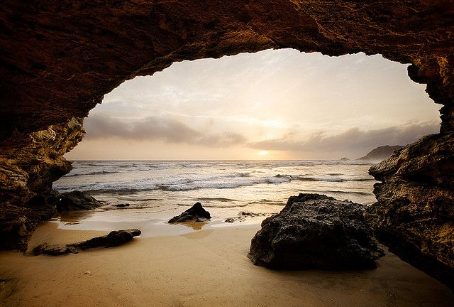 Sedgefield - South Africa: Sea Cave    Warm light illuminates a cave along the Sedgefield coastline in the Garden Route of South Africa.