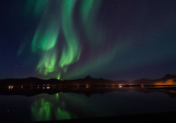 Multicolored cosmic lights dance over mountains, bridges and lakes in an amazing new video that highlights the beauty of the northern lights as seen from Norway.