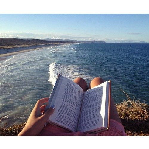 I love reading at the beach! I always bring a read book b/c I know I would destroy my e reader. haha Beach, waves, water, grass, dress, book, reading, sun.