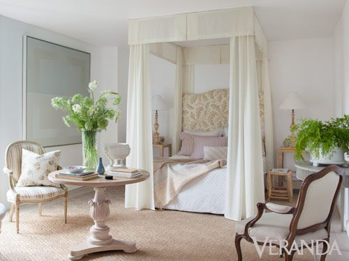 To accentuate the height of the master bedroom, Randolph designed a ceiling-high canopy and extra-tall headboard.