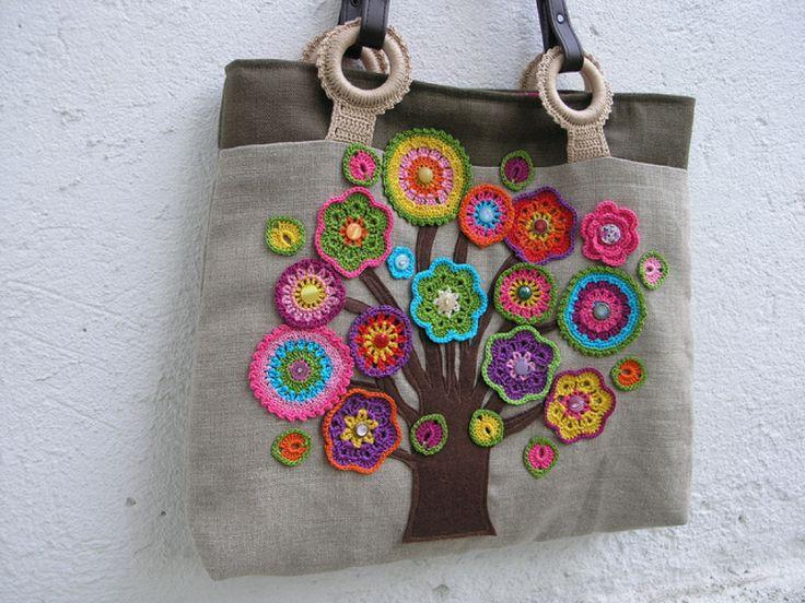 Crochet flowers on a handbag.