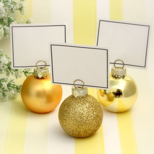 gold bauble place card holders a perfect festive touch for winter themed or christmas weddings