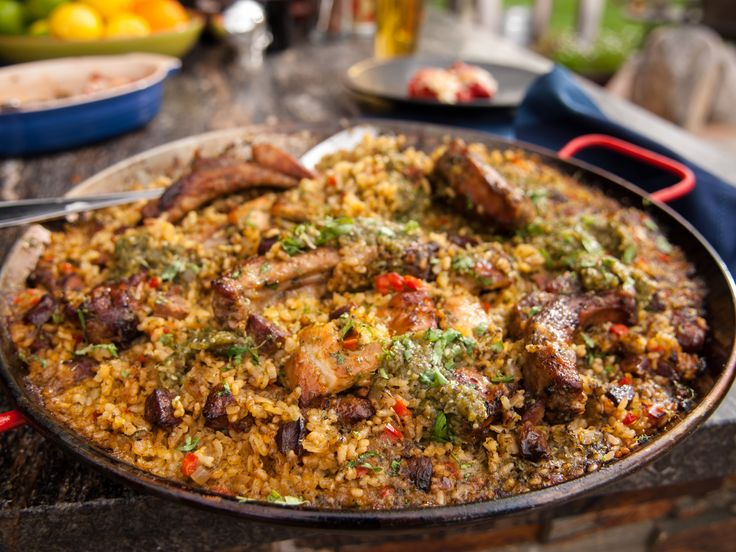 Get this all-star, easy-to-follow Pork and Chicken Paella Verde recipe from Guy Fieri