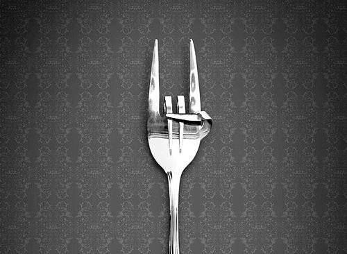 Either this fork is warding off MALOCCHIO....or it says ITALIANS ROCK!!!! Lol
