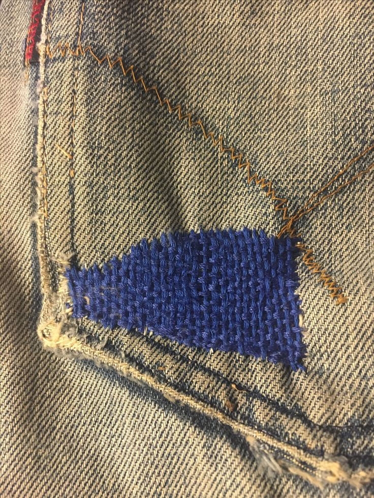 Woven mending on jeans pocket. Love the contrast