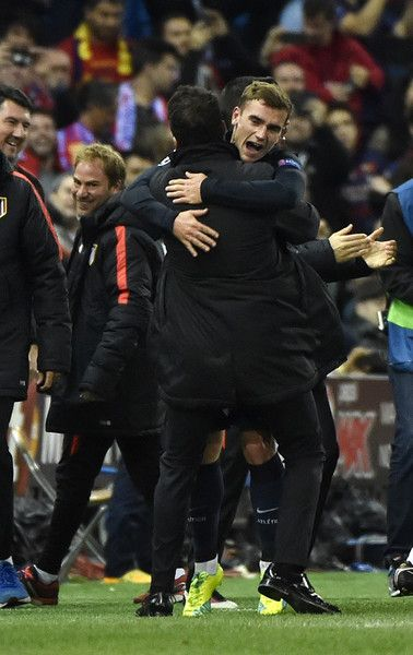 Atletico Madrid's French forward Antoine Griezmann (R) celebrates with Atletico Madrid's Argentinian coach Diego Simeone after scoring a second goal during the Champions League quarter-final second leg football match Club Atletico de Madrid VS FC Barcelona at the Vicente Calderon stadium in Madrid on April 13, 2016.