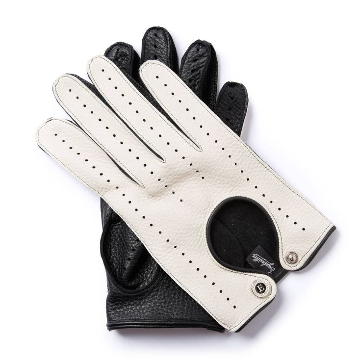 N.V.65 GENTLEMAN DRIVER COLLECTION   These gloves paid tribute to the best racing years of the Italian Formula 1 driver Nino Vaccarella who won the Targa Florio three times, first in 1965. The strong but soft American deerskin is comfortable and supple enough for driving. The vent exposing the back of the hand is a distinctive feature.  American deerskin
