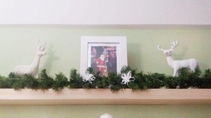 DIY - Top shelf Christmas decor with sparlyn reindeer's and a sparklyn photo frame.