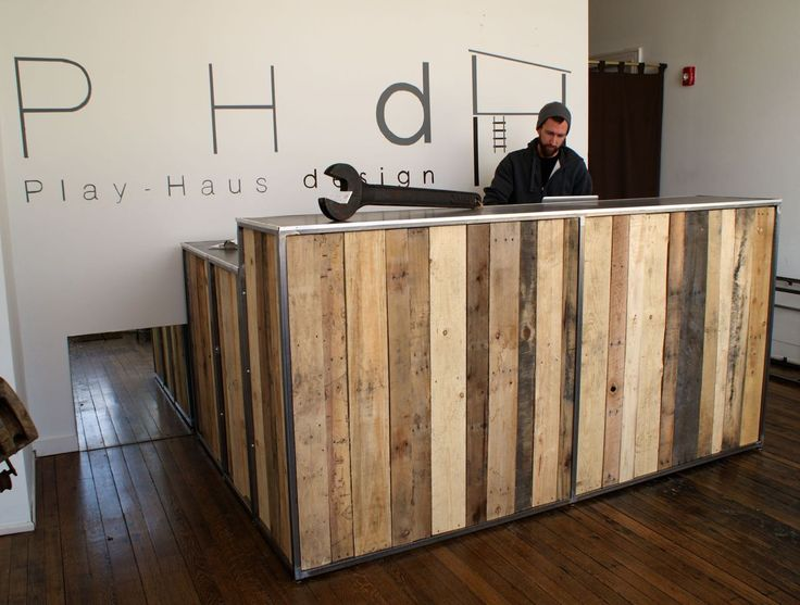 Reclaimed Pallet wood desk with a steel top and steel frame.