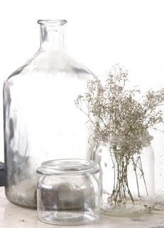 clear glass jars and jug with simple wildflowers