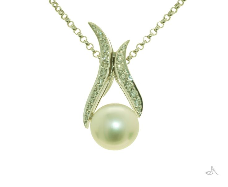 I love this piece!  A real statement, sparkling diamond set bail holding on to a gorgeous white south sea pearl xx