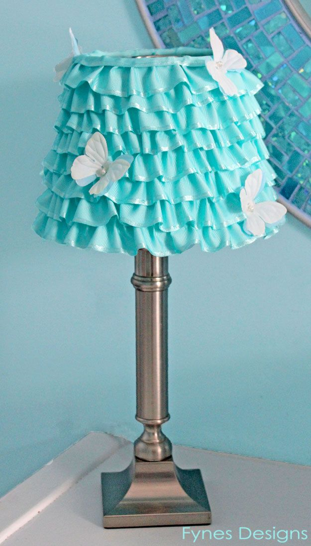 Jeannie Springer I can see you incorporating the Sashay yarn on this project maybe for a nursery or a little girl's room......DIY Ribbon Lamp Shade