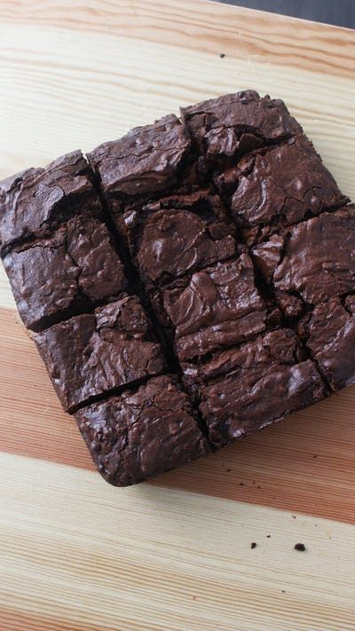 Recipe with video instructions: These are quite possibly the most chewy, moist brownies we've ever made. Ingredients: 12 oz bittersweet chocolate, melted, 1 cup unsalted butter, melted, 3 cups granulated sugar, 6 eggs, ½ cup cocoa powder, pinch of salt, 1 ¼ cups all-purpose flour, ¾ cup mini chocolate chips