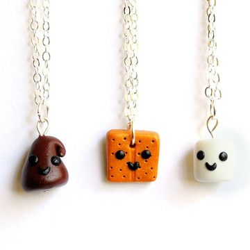 S'more BFF Necklaces.@Trevin Chow Bellingar @Amanda Snelson Sutten  Normally, I would want to be the chocolate chip- but that looks like a happy turd. I'll take the graham cracker.