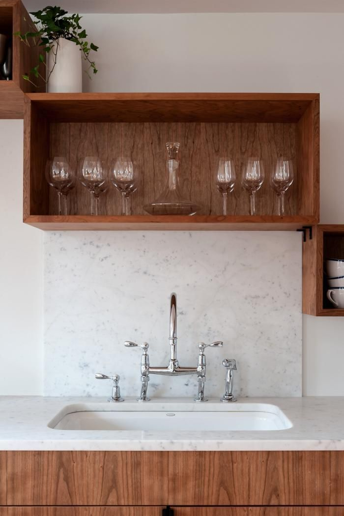 Remodelista, Workstead, Brooklyn Heights, cherry hardwood storage boxes on white kitchen wall, white cararra marble backsplash and counter