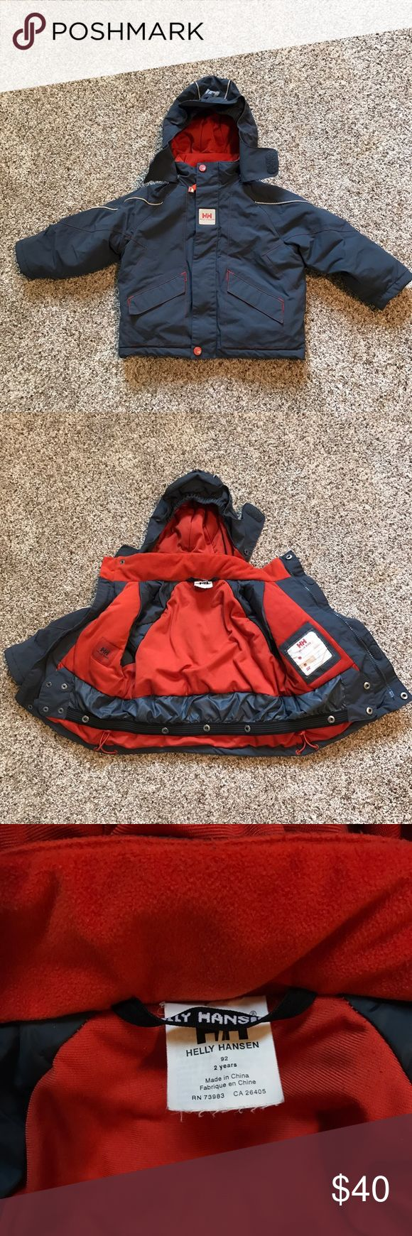 Helly Hansen Grey Orange Snowboard Jacket Size 2T Helly Hansen Grey and Burnt Orange Snowboard Jacket. Has a snapping snowskirt inside, detachable hood, all zippers and snaps work great. Size 2T. Worn twice, looks like new. Helly Hansen Jackets & Coats Puffers