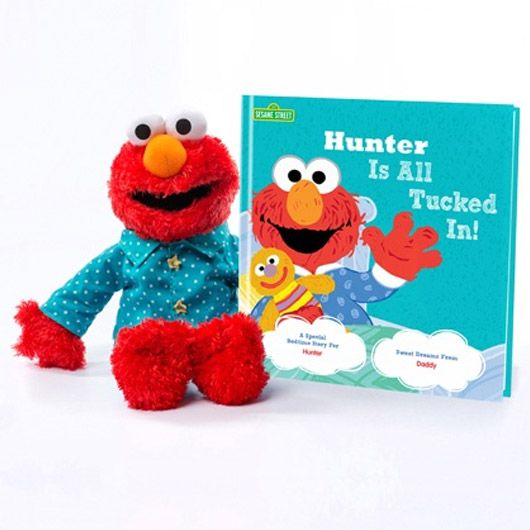 Elmo is ready to snuggle up and read a special bedtime story all about your special child in this All Tucked In on Sesame Street gift set!