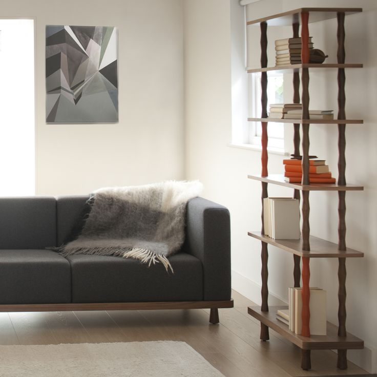 'Podium' sofa and 'Campaign' shelves, both by Alex Hellum for J+J