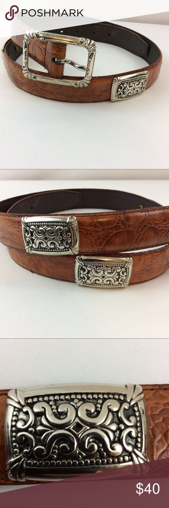 """LEATHER CONCHO BELT NEW I don't  think I wore this and if so it was one time so it's perfect condition!  Beautiful design on the (4) conchos, the belt buckle has an intricate design as well! LEATHER/sz M/5 hole adjustment! MEASUREMENTS: Length: 36 1/2"""" (without buckle)>>width: 1"""">> (4) Conchos: 1 1/2"""" long & 1""""wide>>Buckle: 2 1/4"""" long & 1 3/4 wide 🔥BRANDED FOR VIEWS--no brand listed on belt🔥 Free People Accessories Belts"""