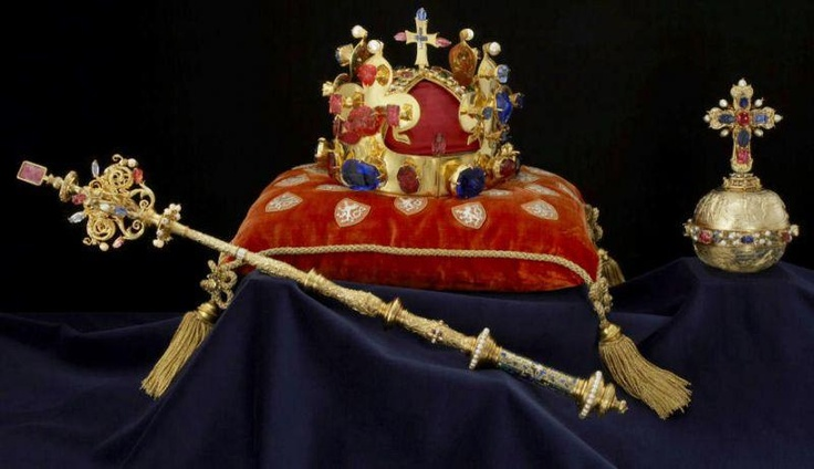 The Czech Crown Jewels include the Crown of Saint Wenceslas (Svatováclavská koruna), the royal orb & sceptre, the coronation vestments of the Bohemian kings, the gold reliquary cross, & St. Wenceslas' sword. It was originally held in Karlštejn Castle, designed in the 14th century by Matthias of Arras. Since 1867 it has been stored in St. Vitus Cathedral of Prague Castle. The crown was made for the coronation of Charles IV in 1347, making it the fourth oldest in Europe.