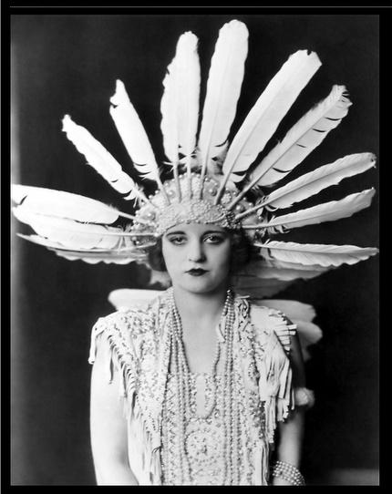 Actress Tallulah Bankhead in turkey feather headdress