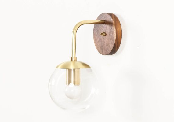 """OVERVIEW  A mid-century inspired, handcrafted sconce with wood and brass accents and glass globe shade.  DETAILS   Dimensions: 7.5""""D x 6""""W x 12""""H, Wood base: 5""""W, Glass globe: 6W  Hardwired, Professional installation required  Push switch installed on base  E26 base 