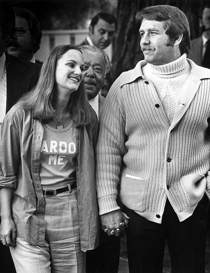 Feb. 1, 1979: After President Carter commuted her seven-year sentence for armed robbery, Patricia Hearst was released from prison, having served 22 months. She and her bodyguard, Bernard Shaw, stand outside her mother's home in Hillsborough, Calif. Hearst and Shaw were married two months later. Hearst was a captive-turned-comrade of a group of 1970s radicals, the Symbionese Liberation Army. She was kidnapped on Feb. 4, 1974, at age 19.