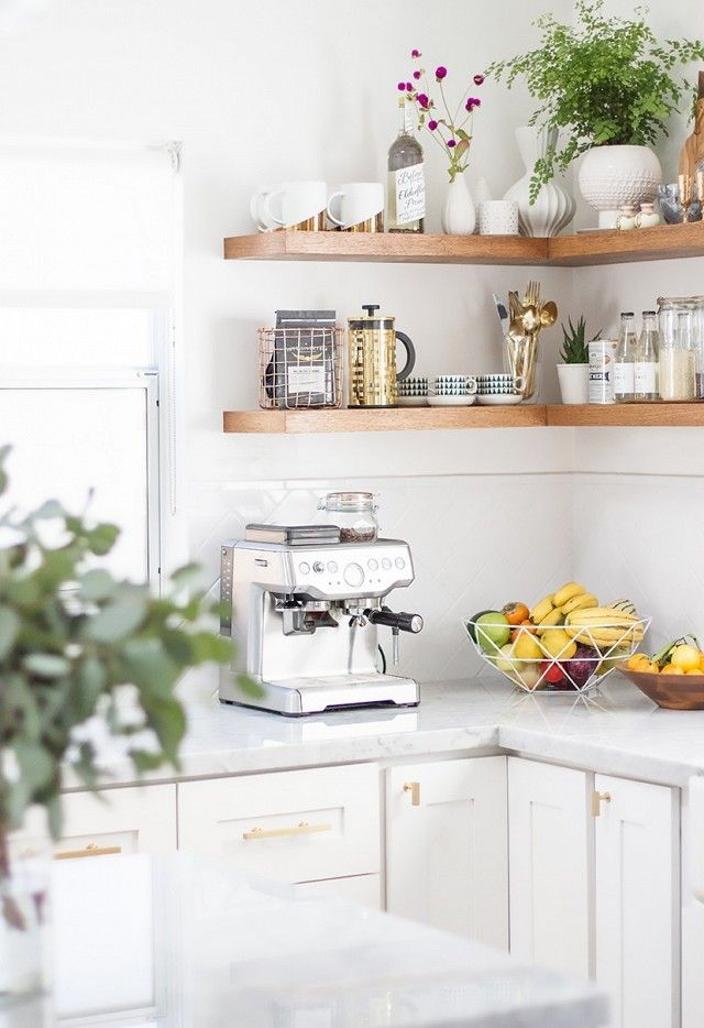 """""""I wanted the kitchen to be bright, bright, bright,"""" she says. She picked white shaker cabinets, marble countertops, and a herringbone subway tile backsplash as a backdrop, and added in texture..."""