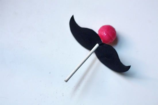 Moustache lolly pops! hahah ... add a paper moustache onto the stick and when people suck on their lolly pop they will have a fashionable stache' to go with it! :-)