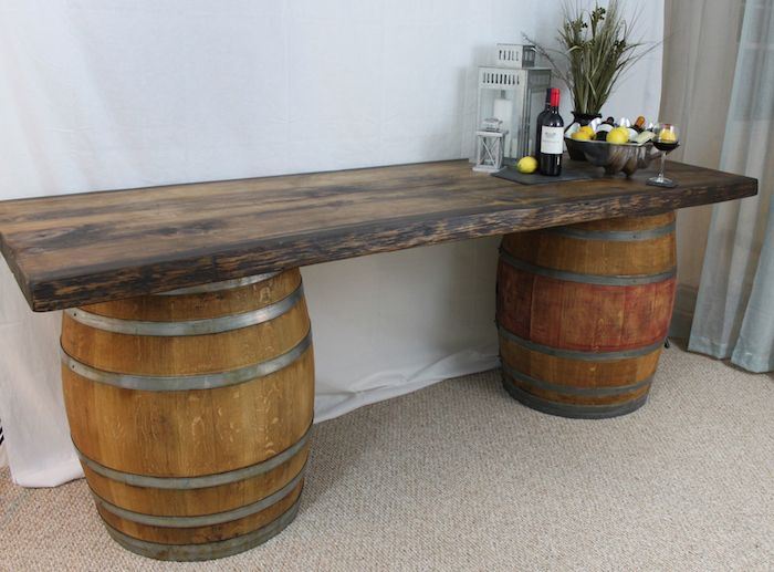Rustic Wood Top And Wine Barrel Buffet Table.