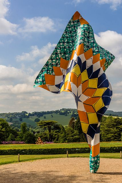 Yinka Shonibare African Batik Sculpture - Yorkshire Sculpture Park-4 | Flickr - Photo Sharing! Yinka Shonibare, MBE, is a British-Nigerian artist living in London whose work explores cultural identity, colonialism and post-colonialism within the contemporary context of globalisation. He had been nominated for the Turner Prize.
