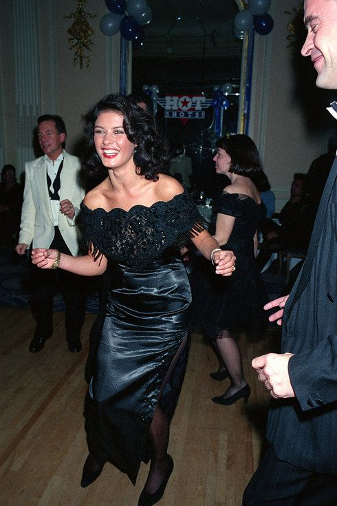 Catherine Zeta-Jones (left) and Elizabeth Hurley, seen in 1991. | Celebrities Let Their Hair Down In Raucous Party Photos Spanning Four Decades