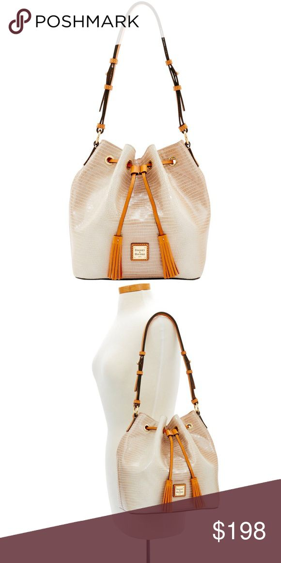 "Dooney&Bourke Serena Drawstring Pearl/Butterscotch Get a fresh perspective on cool handbag decorum with this sophisticated yet street-chic crossbody Fashioned in luxe Saffiano leather with gold hardware, the adjustable strap offers custom-fit carrying.  Adjustable chain/leather strap with 24.5"" drop.  Zip top closure; east-west silhouette.  Inside, logo fabric lining and slip pockets.  6.5""H x 9.5""W x 2.3""D. Dooney & Bourke Bags Shoulder Bags"