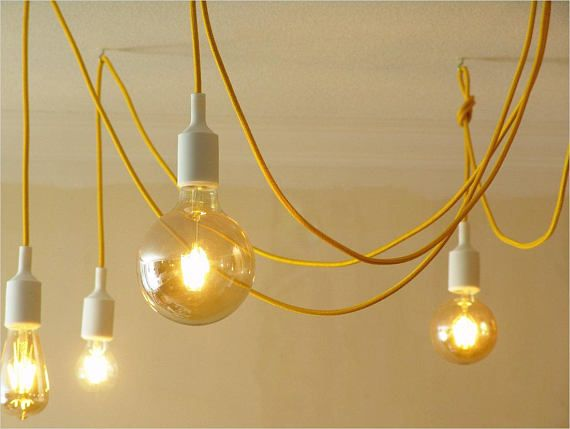 Sunny mood for warmer autumn season. Chandeliers of fabric cable in yellow color. Eight tails 1,6 meters long each. When placed on the ceiling, looks like a circle about 150 centimeters in diameter and eight pendants 60 centimeters long each with standard E27 lamp holder in silicone