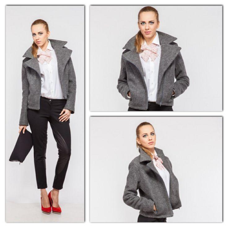 Grey wool biker jacket with metallic zipper. Available size in showroom 36 european.