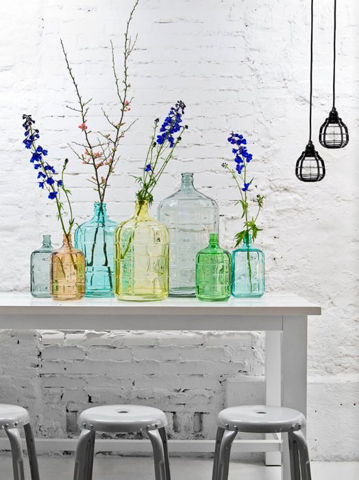 HKLiving | Paulina Arcklin / decorate with various sizes and colors of glass bottles