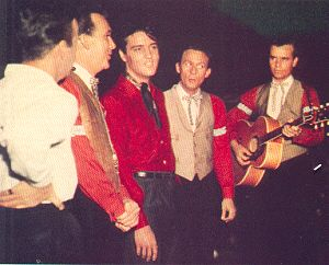 From: Broadway To Vegas January 2, 2000   ELVIS PRESLEY (center) surrounded by THE JORDANNAIRES (1957) the most famous back up group of all time, who live in and regularly perform in Las Vegas.