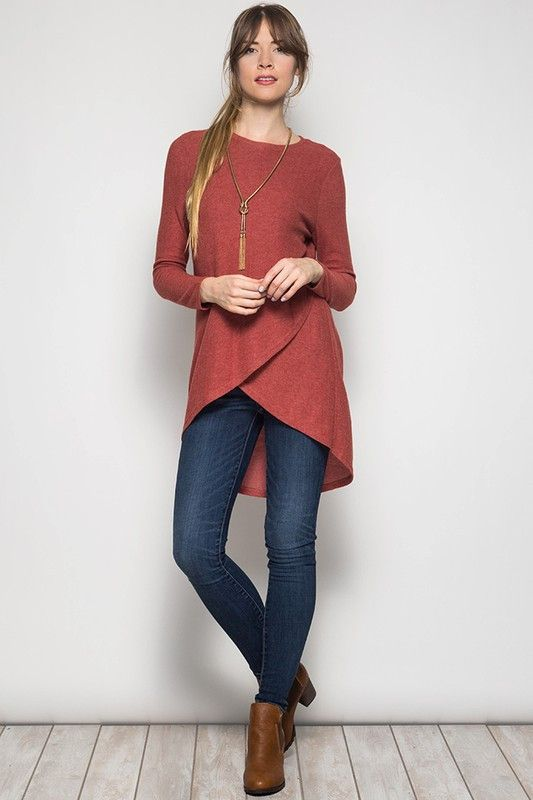 A unique twist on the long sleeve tunic! Features a tulip front overlapping detail, back pleat, and high-low fit. 60% Cotton 40% Rayon