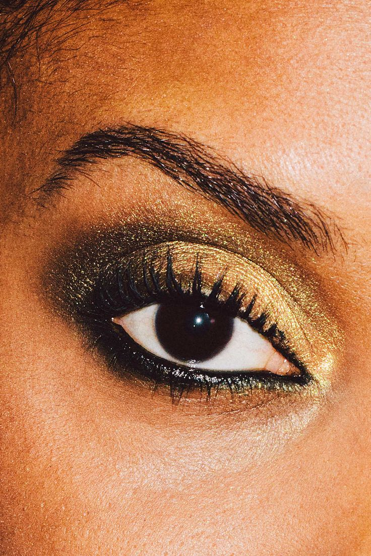 Pair a gold eye with a slightly smoky black liner for a smoldering look. Try MAC Gold Pigment, paired with Clé de Peau Beauté Intensifying Cream Eyeliner.